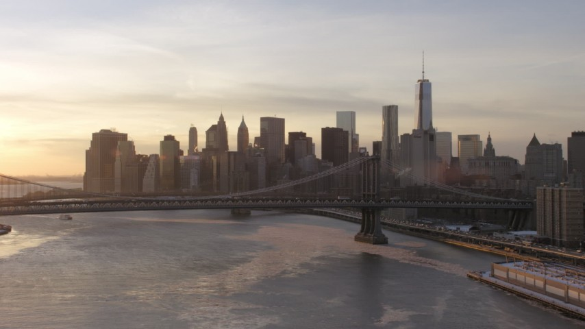 Manhattan Bridge and Lower Manhattan skyline, New York City Sunset Aerial Stock Footage AX66_0232
