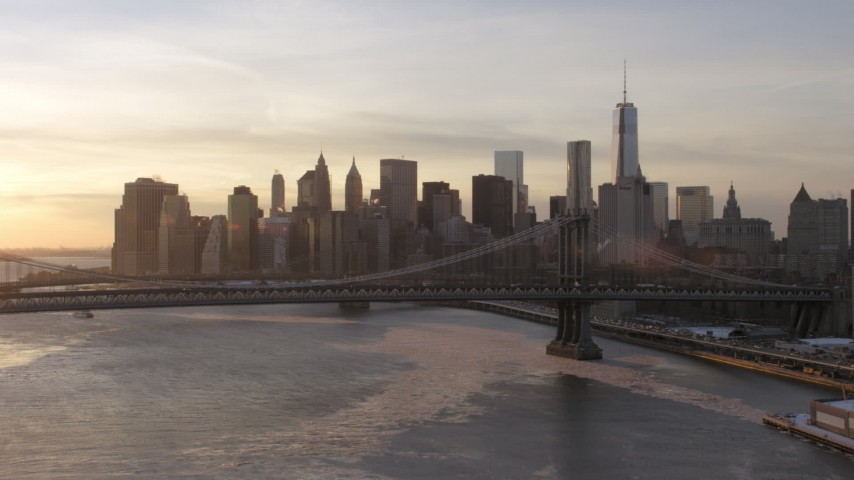 5K stock footage aerial video approach Manhattan Bridge and Lower Manhattan skyline, New York City, sunset Aerial Stock Footage | AX66_0232
