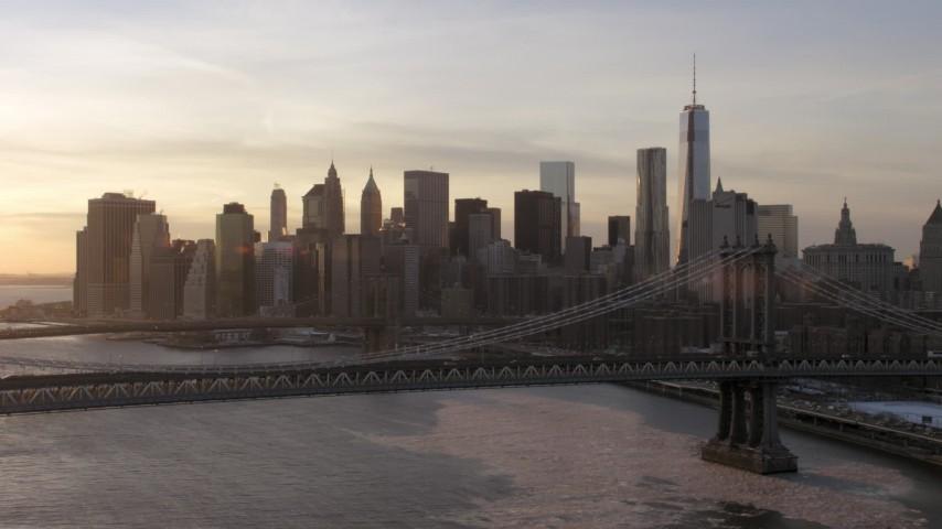 Manhattan Bridge and Brooklyn Bridge with Lower Manhattan, New York City Sunset Aerial Stock Footage | AX66_0233