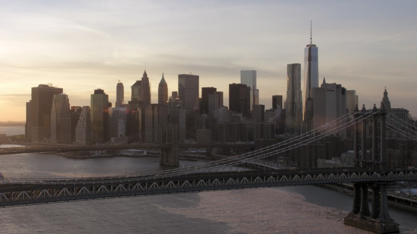 5K stock footage aerial video approach Manhattan Bridge, Brooklyn Bridge and Lower Manhattan, New York City, sunset Aerial Stock Footage AX66_0233 | Axiom Images