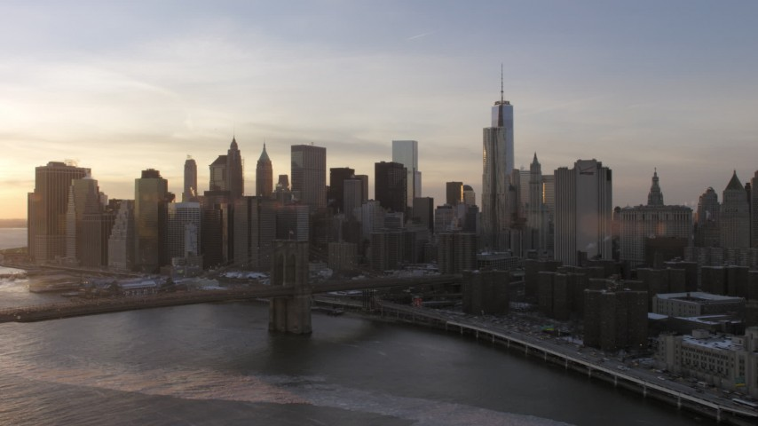 5K aerial video approach Brooklyn Bridge and Lower Manhattan skyline, New York City, sunset Aerial Stock Footage | AX66_0234