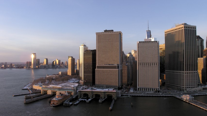 5K stock footage aerial video of Lower Manhattan skyscrapers and Battery Park, New York City at sunset Aerial Stock Footage | AX66_0238