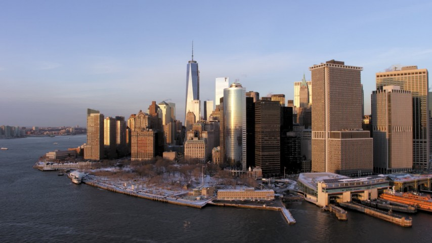 5K stock footage aerial video orbit Lower Manhattan skyscrapers and Battery Park with snow, New York City, sunset Aerial Stock Footage | AX66_0239