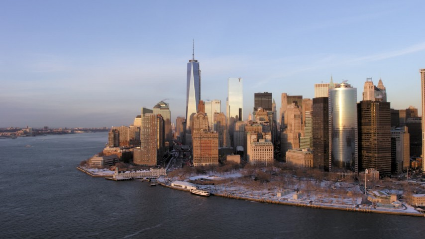 5K stock footage aerial video of One World Trade Center and Battery Park with snow, Lower Manhattan, New York City, sunset Aerial Stock Footage | AX66_0240