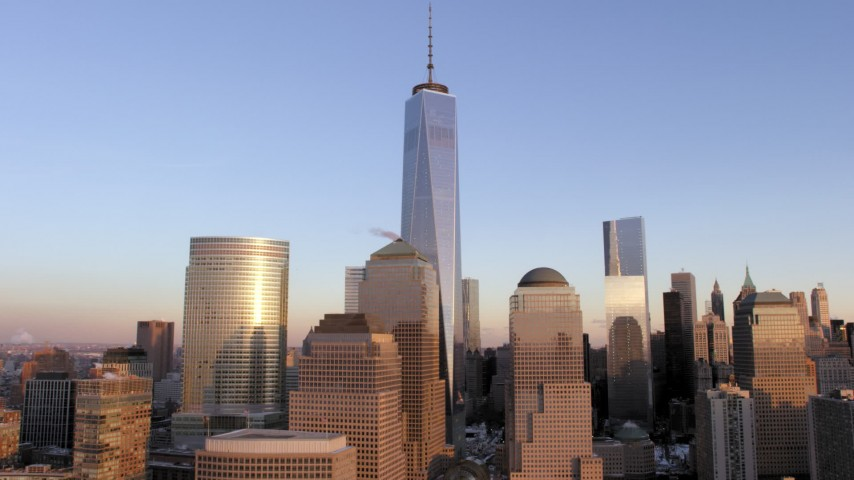 5K stock footage aerial video Lower Manhattan skyscrapers around One World Trade Center in snow, New York City, sunset Aerial Stock Footage | AX66_0244
