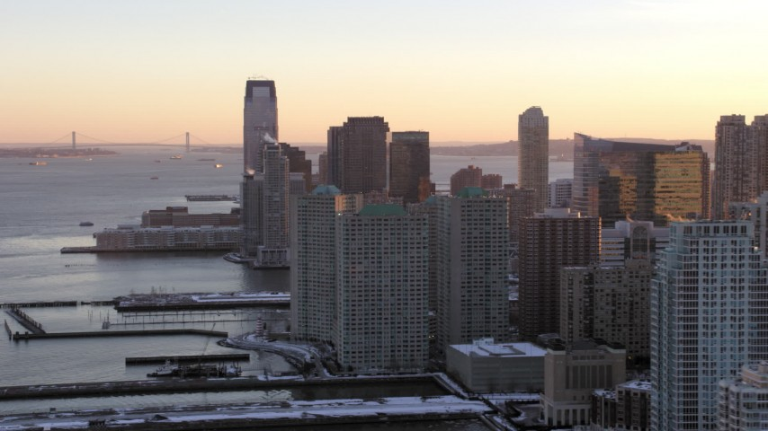 5K stock footage aerial video of Downtown Jersey City skyscrapers, New Jersey, sunset Aerial Stock Footage | AX66_0246