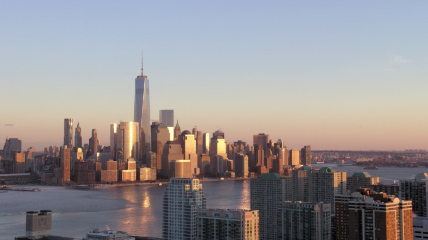 5K stock footage aerial video of the Lower Manhattan skyline across the river, New York City, sunset Aerial Stock Footage | AX66_0248
