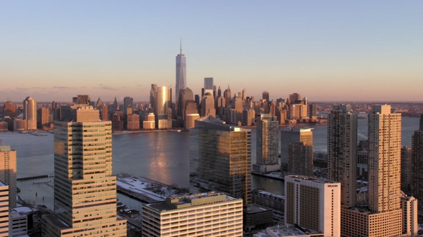 5K stock footage aerial video approach Lower Manhattan skyline, New York City, sunset, from Jersey City Aerial Stock Footage | AX66_0250