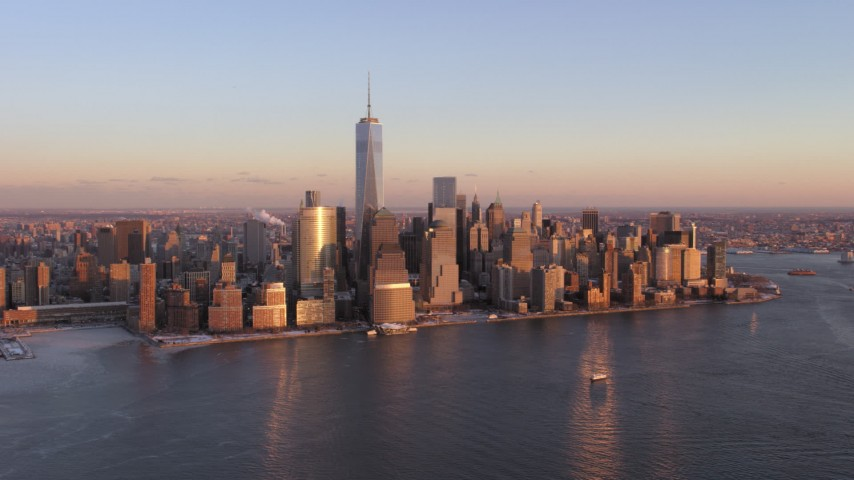 5K stock footage aerial video of Lower Manhattan skyline and One World Trade Center, New York City, sunset Aerial Stock Footage | AX66_0252