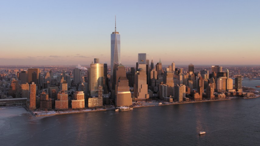 Lower Manhattan Skyscrapers and One World Trade Center, New York City Sunset Aerial Stock Footage | AX66_0253