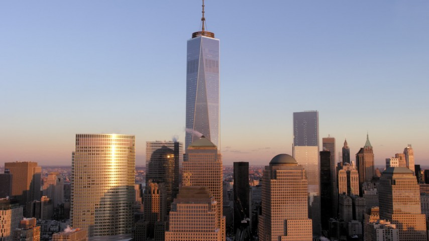 5K stock footage aerial video tilt to top of One World Trade Center, Lower Manhattan, New York City, sunset Aerial Stock Footage | AX66_0255