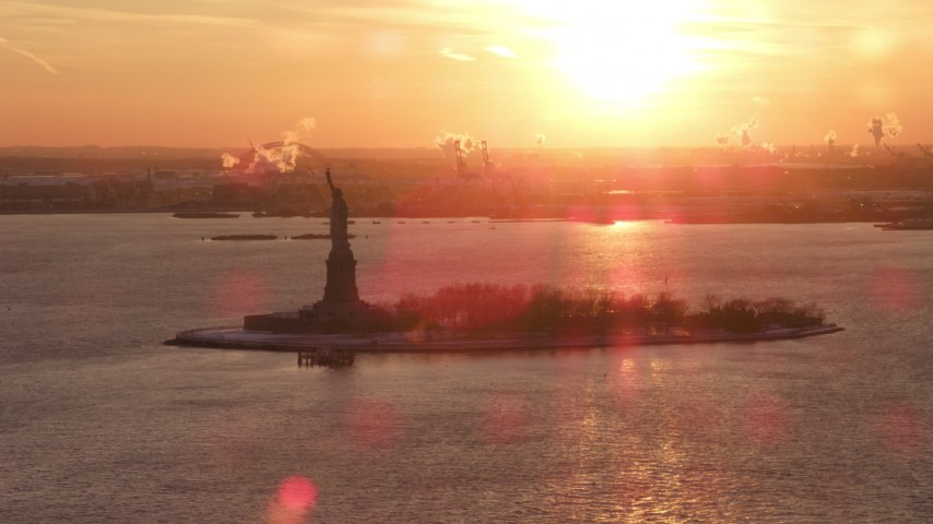 5K stock footage aerial video of the Statue of Liberty, New York City, sunset Aerial Stock Footage | AX66_0258