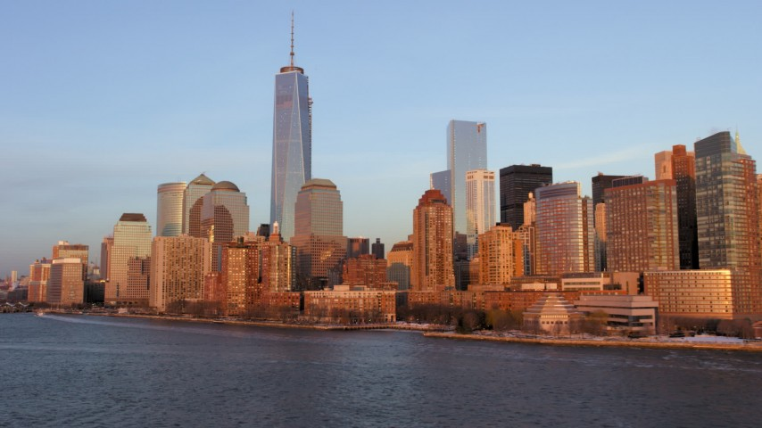 5K stock footage aerial video of One World Trade Center and Lower Manhattan skyline, New York City, sunset Aerial Stock Footage | AX66_0262