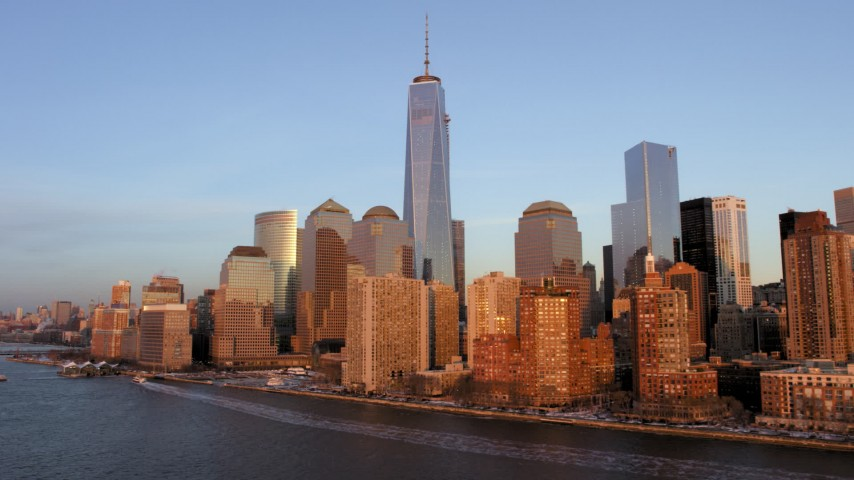 5K aerial video of One World Trade Center  and the Lower Manhattan skyline, New York City, sunset Aerial Stock Footage | AX66_0263