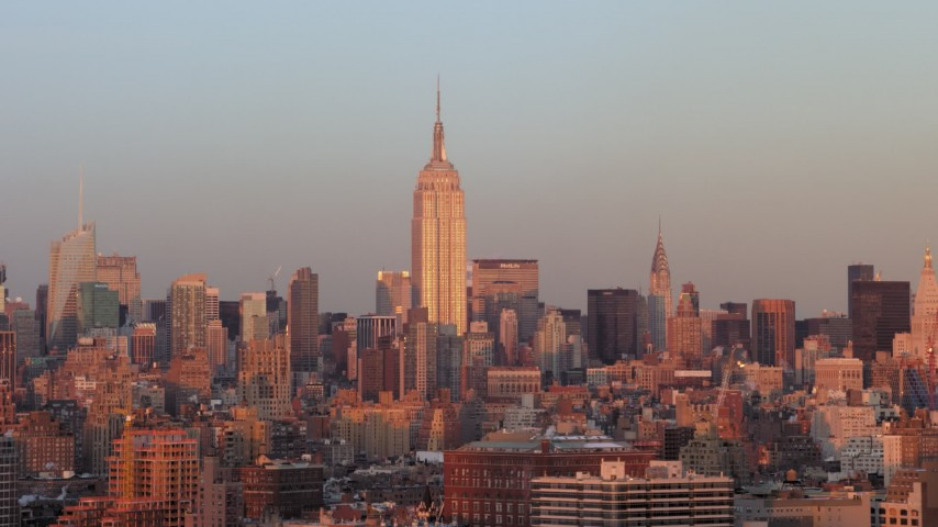 5K stock footage aerial video of the Empire State Building and Midtown skyscrapers in New York City, sunset Aerial Stock Footage | AX66_0266