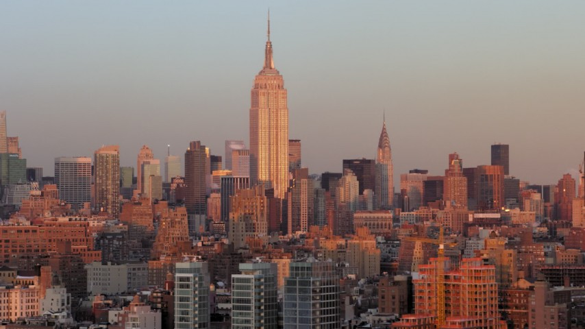 5K stock footage aerial video of the iconic Empire State Building, Midtown Manhattan, New York City, sunset Aerial Stock Footage | AX66_0267
