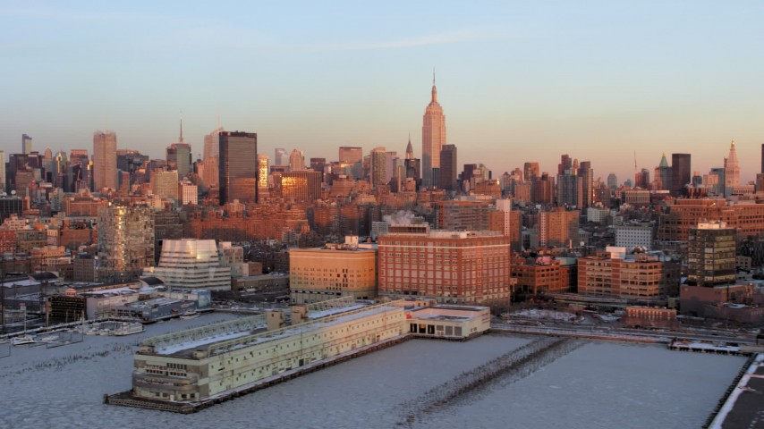 5K stock footage aerial video a view of the Empire State Building from Chelsea Piers, Midtown Manhattan, New York City, sunset Aerial Stock Footage | AX66_0269