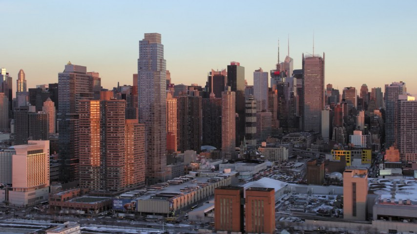 5K stock footage aerial video of Midtown Manhattan's Hell's Kitchen in winter, New York City, sunset Aerial Stock Footage | AX66_0272