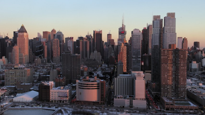 Midtown Manhattan Hell's Kitchen in winter, New York City Sunset Aerial Stock Footage | AX66_0273