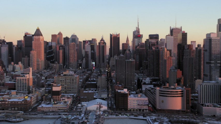 5K stock footage aerial video of Midtown Manhattan skyscrapers in Hell's Kitchen in winter, New York City, sunset Aerial Stock Footage | AX66_0273