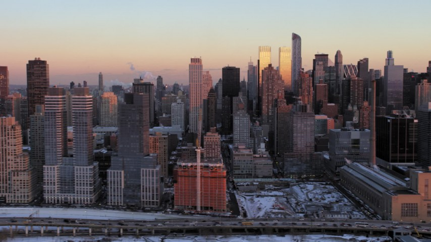 5K stock footage aerial video of Hell's Kitchen, Midtown Manhattan in winter, New York City, sunset Aerial Stock Footage | AX66_0275