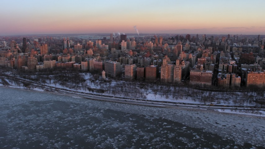 5K stock footage aerial video of Upper West Side apartment buildings and park in winter, New York City, twilight Aerial Stock Footage AX66_0277 | Axiom Images