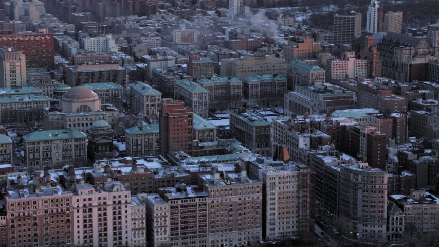 5K stock footage aerial video of the snowy Columbia University campus in winter, New York City, twilight Aerial Stock Footage | AX66_0281