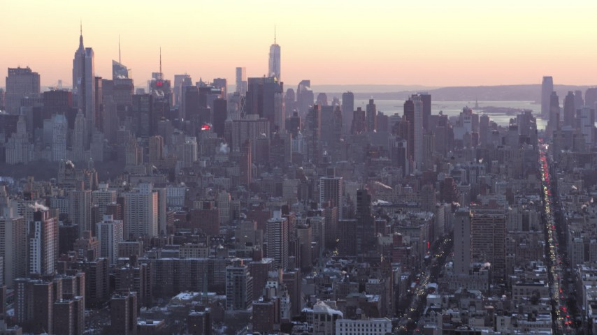 5K stock footage aerial video tilt from Columbia University to Midtown skyscrapers in winter, New York City, twilight Aerial Stock Footage | AX66_0282