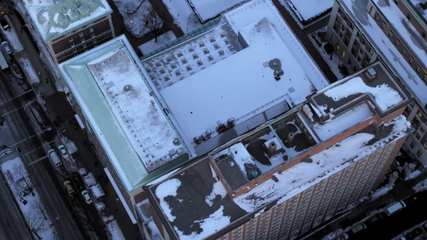 5K stock footage aerial video of a bird's eye view of a Columbia University building in winter, New York City, twilight Aerial Stock Footage | AX66_0284