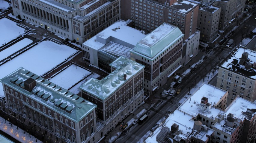 5K stock footage aerial video fly away from Columbia University in winter, New York City, twilight Aerial Stock Footage | AX66_0285