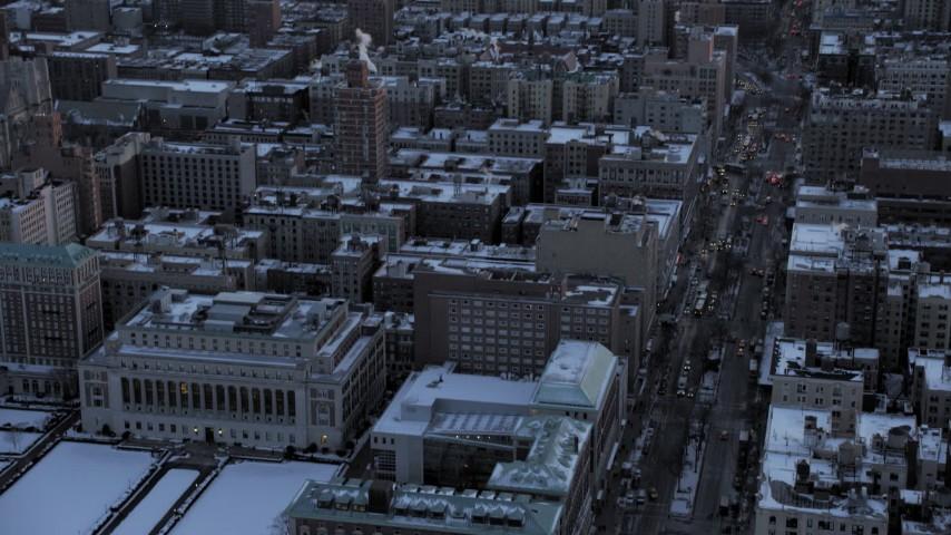 Columbia University tilt up and reveal Midtown Manhattan skyline in winter, New York City twilight Aerial Stock Footage | AX66_0286