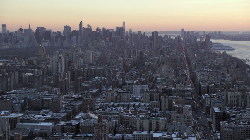 5K aerial video tilt from Midtown skyline, reveal Columbia University in winter, New York City, twilight Aerial Stock Footage | AX66_0287
