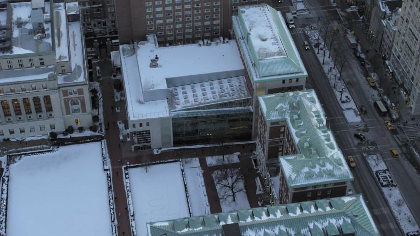 Bird's Eye Columbia University campus in winter, New York City twilight Aerial Stock Footage | AX66_0288