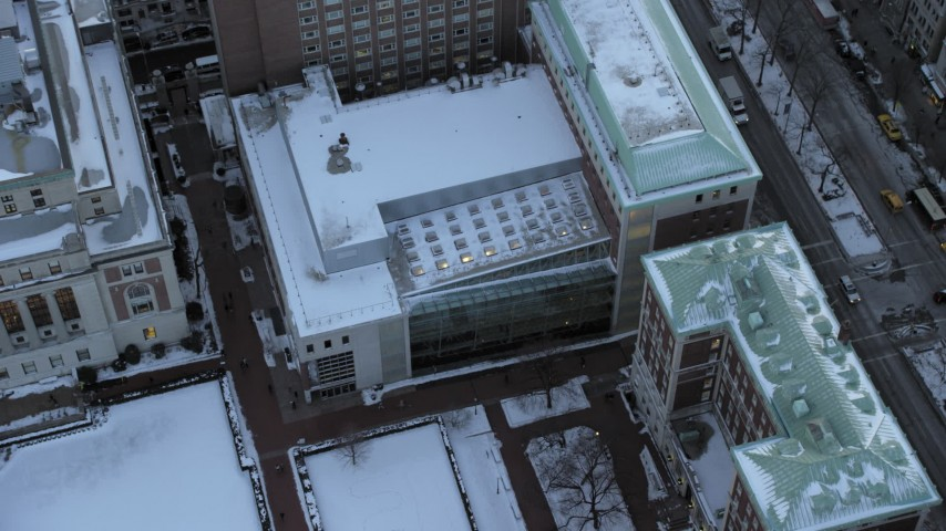 5K aerial video of a bird's eye of Columbia University campus in winter, New York City, twilight Aerial Stock Footage | AX66_0288