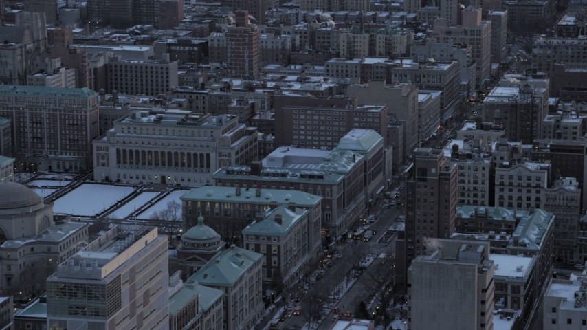 5K stock footage aerial video of Midtown skyline, tilt to Columbia University in winter, New York City, twilight Aerial Stock Footage | AX66_0292