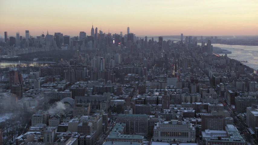 5K stock footage aerial video tilt from Midtown to reveal Columbia University in winter, New York City, twilight Aerial Stock Footage | AX66_0293