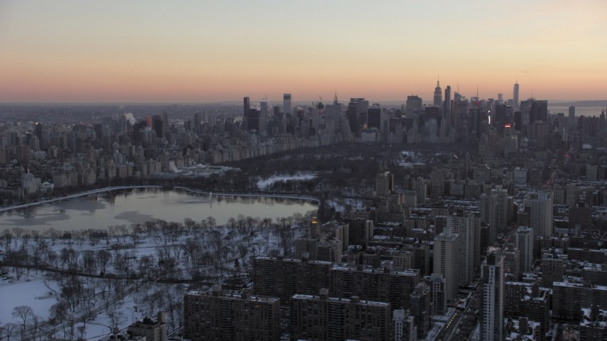 5K stock footage aerial video of Central Park in winter, New York City, twilight Aerial Stock Footage | AX66_0295