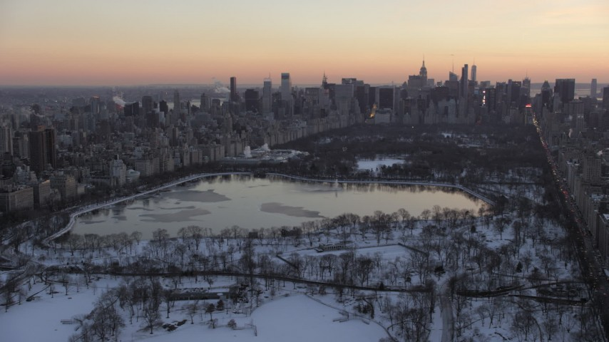 5K stock footage aerial video of Central Park and Midtown Manhattan skyline in winter, New York City, twilight Aerial Stock Footage | AX66_0296