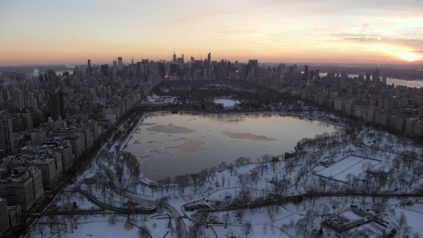 Central Park and Midtown Manhattan skyline in winter, New York City twilight Aerial Stock Footage   AX66_0298
