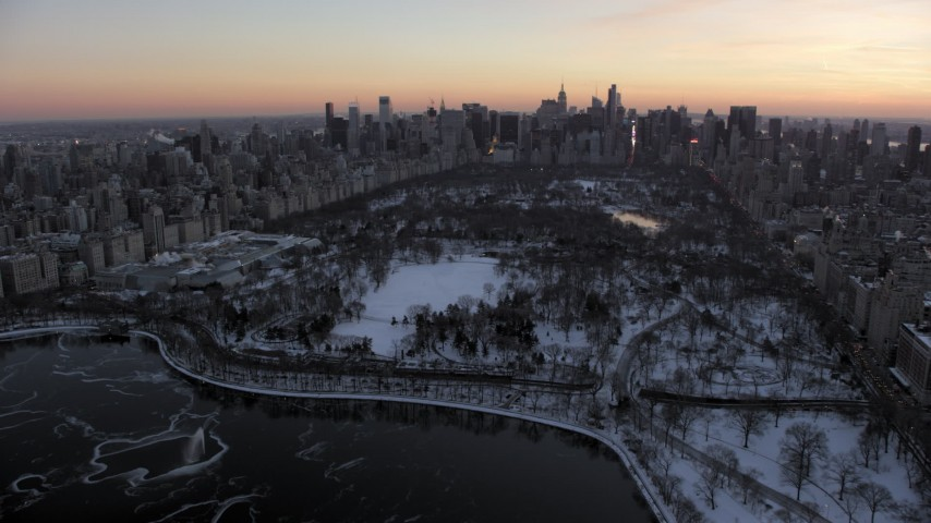 5K stock footage aerial video of Central Park and Metropolitan Museum of Art in winter, New York City, twilight Aerial Stock Footage | AX66_0300