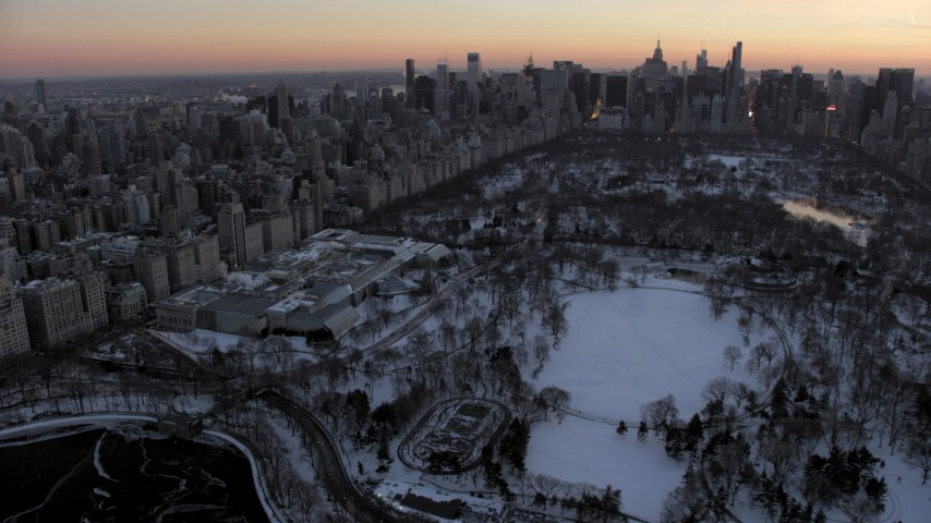 5K stock footage aerial video approach Metropolitan Museum of Art in Central Park in winter, New York City, twilight Aerial Stock Footage | AX66_0301