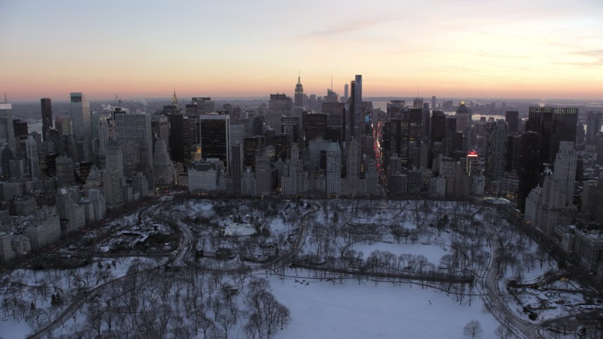 5K stock footage aerial video of Midtown Manhattan skyscrapers in winter, New York City, twilight Aerial Stock Footage | AX66_0307