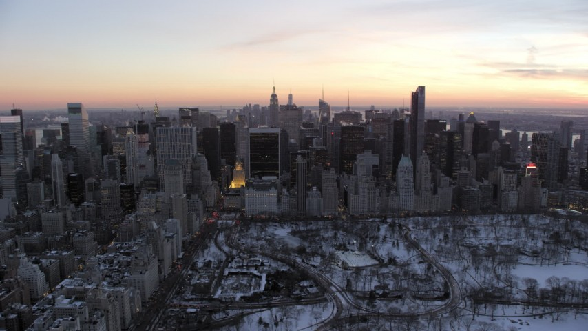 5K stock footage aerial video of Midtown skyscrapers by Central Park in winter, New York City, twilight Aerial Stock Footage | AX66_0308