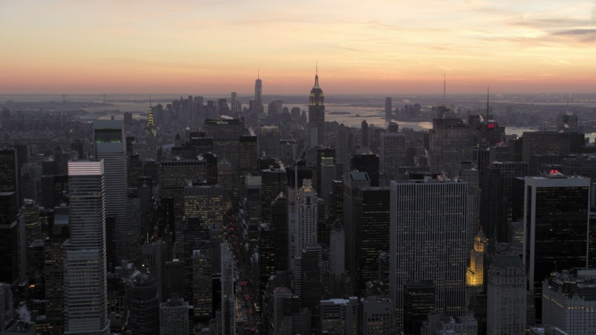 5K stock footage aerial video of a wide view of Midtown skyscrapers in winter, New York City, twilight Aerial Stock Footage | AX66_0309