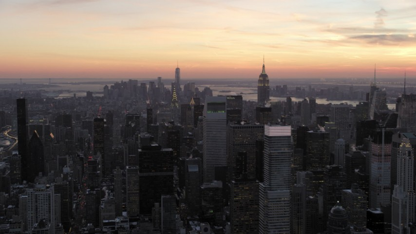 5K stock footage aerial video of skyscrapers in Midtown Manhattan in winter, New York City, twilight Aerial Stock Footage | AX66_0310