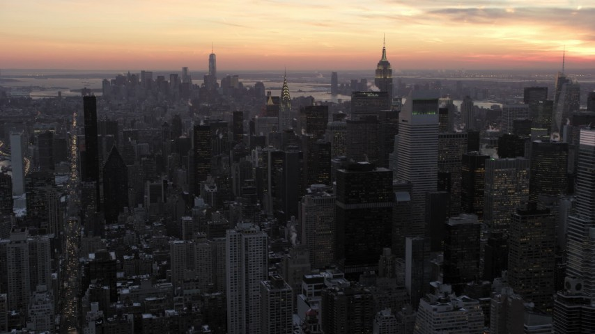 Midtown Manhattan Skyscrapers and Empire State Building in winter, New York City twilight Aerial Stock Footage | AX66_0311