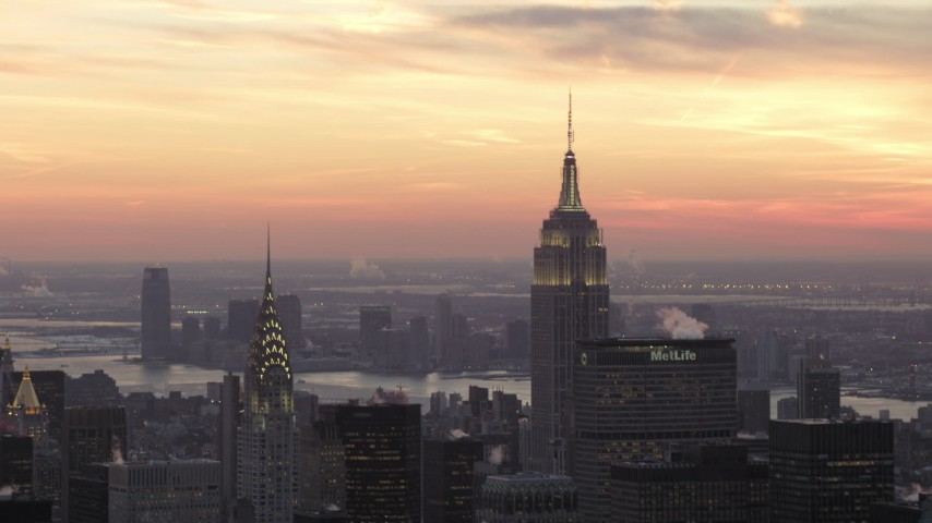 5K stock footage aerial video of Midtown skyscrapers and Empire State Building in winter, New York City, twilight Aerial Stock Footage | AX66_0311