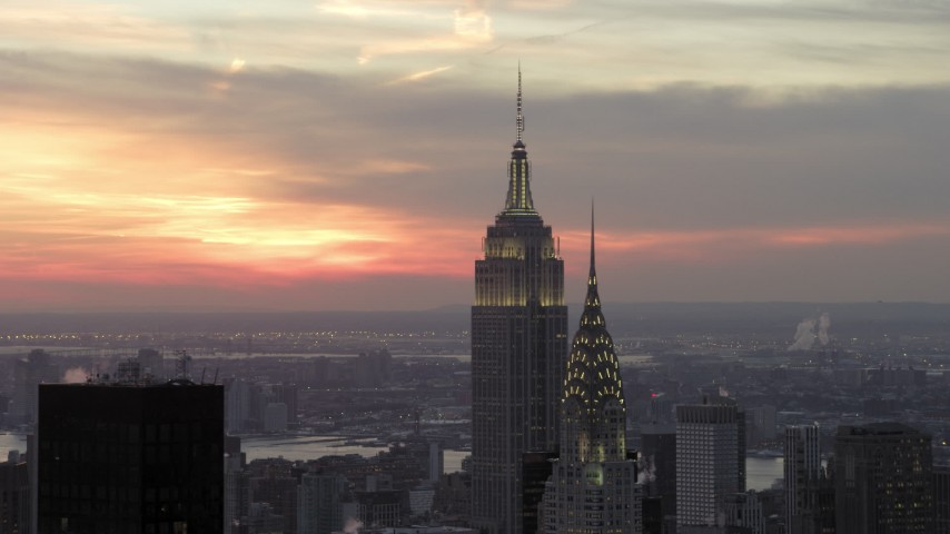 Empire State Building and Chrysler Building in winter, New York City Sunset Aerial Stock Footage | AX66_0315
