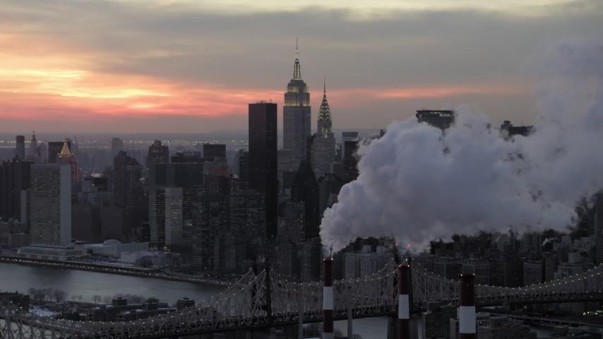 Midtown Manhattan Smoke Stacks in winter, New York City Sunset Aerial Stock Footage   AX66_0317