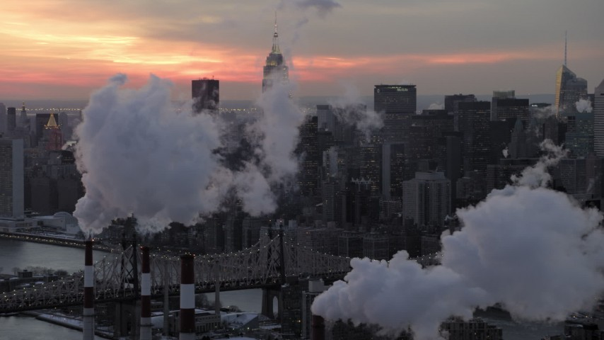 5K stock footage aerial video of Midtown Manhattan smoke stacks and skyscrapers in winter, New York City, twilight Aerial Stock Footage | AX66_0317